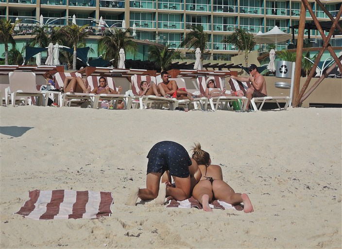 An unusual tanning pose?? Sticking your head in the sand?? Who knows?