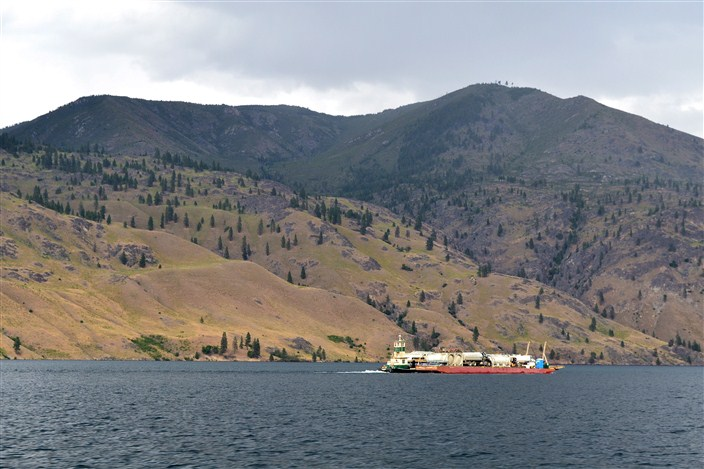 Barge floating supplies between Stehekin and Chelan