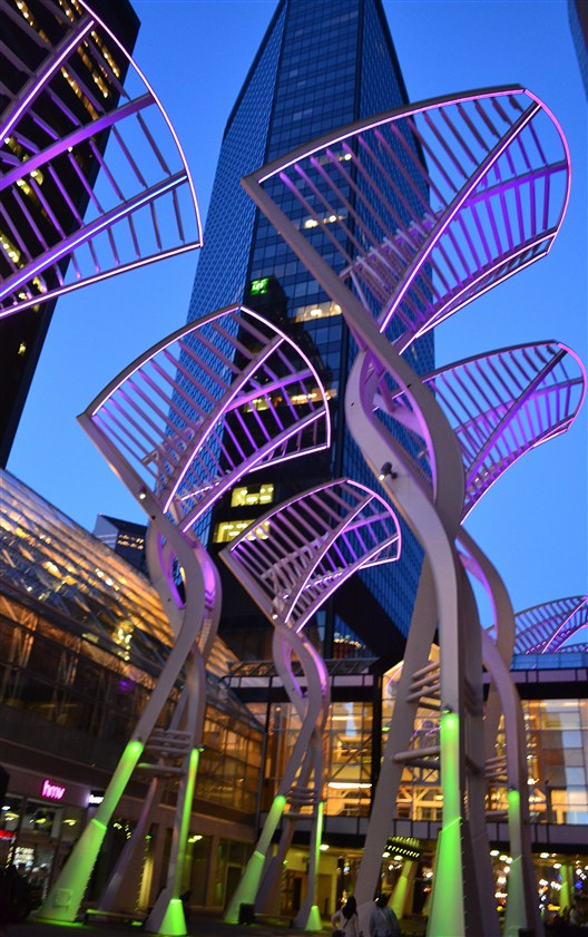 Beware the giant neon spatulas stalking the night streets of Calgary