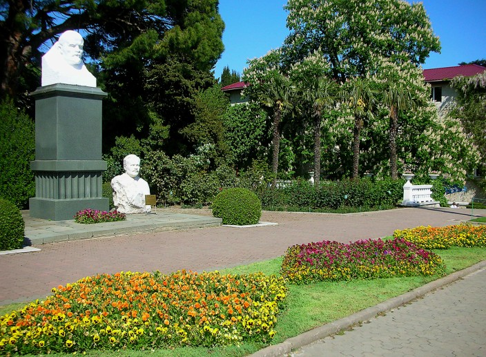 Lenin and some other dude glowering at the flowers