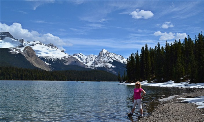 Posing on the shore of Maligne Lake