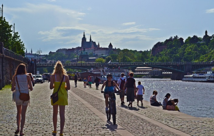 Strolling the banks of the Vltava River, Prague Castle in background