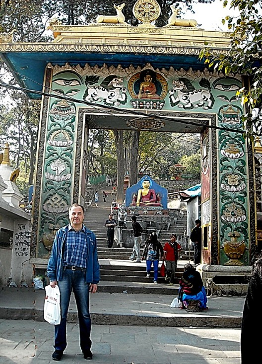 The author poses at a temple grounds entrance