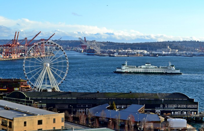 View of Seattle waterfront from the Market: Aquarium building in foreground, Seattle Great Wheel, and Washington State ferry